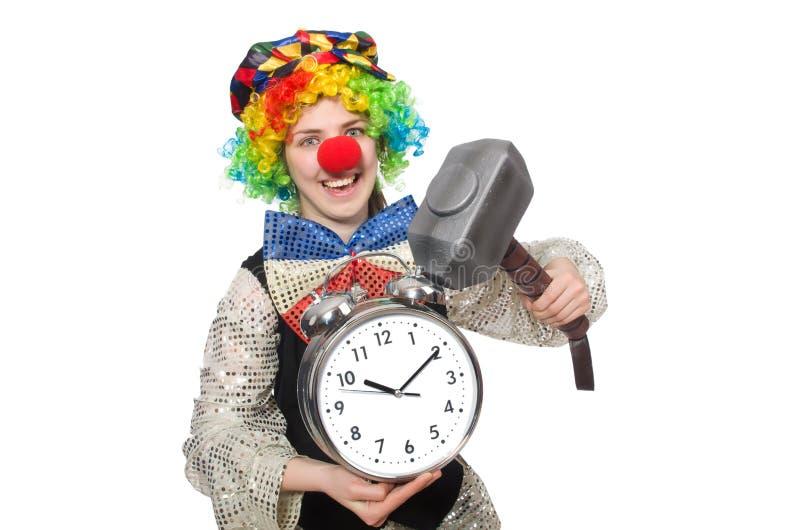 Женский клоун при изолированные будильник и молоток стоковая фотография rf