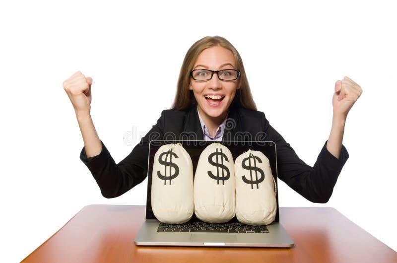 Женский работник с мешками денег на ее таблице стоковая фотография rf