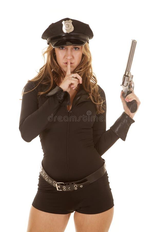 Женский рот перста оружия полисмена стоковое фото