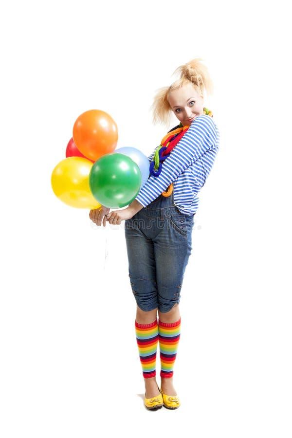 Женский смешной клоун с воздушными шарами стоковое фото