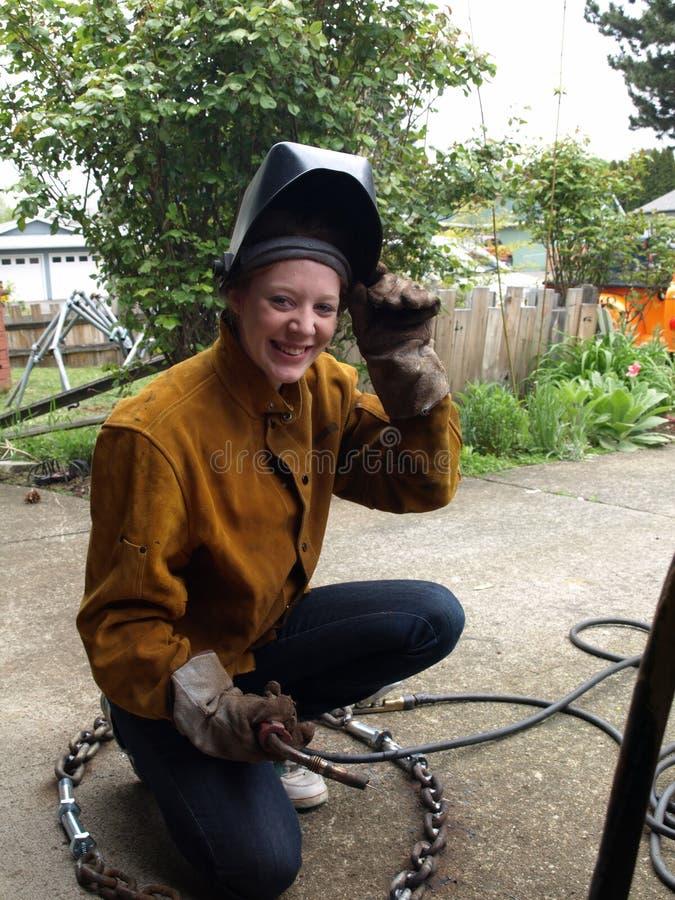 женский сь welder стоковые изображения rf