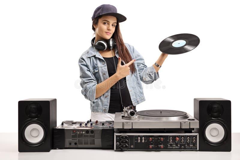 Женский DJ держа показатель и указывать винила стоковые изображения rf