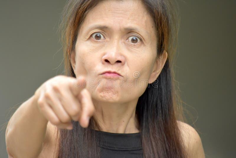 Женское старшее и гнев стоковое фото rf
