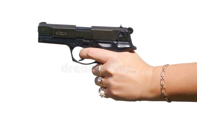 женское удерживание руки пушки стоковое изображение