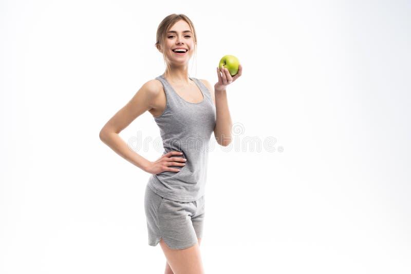 Женское яблоко удерживания модели фитнеса Здоровый съешьте и резвитесь концепцию стоковые изображения