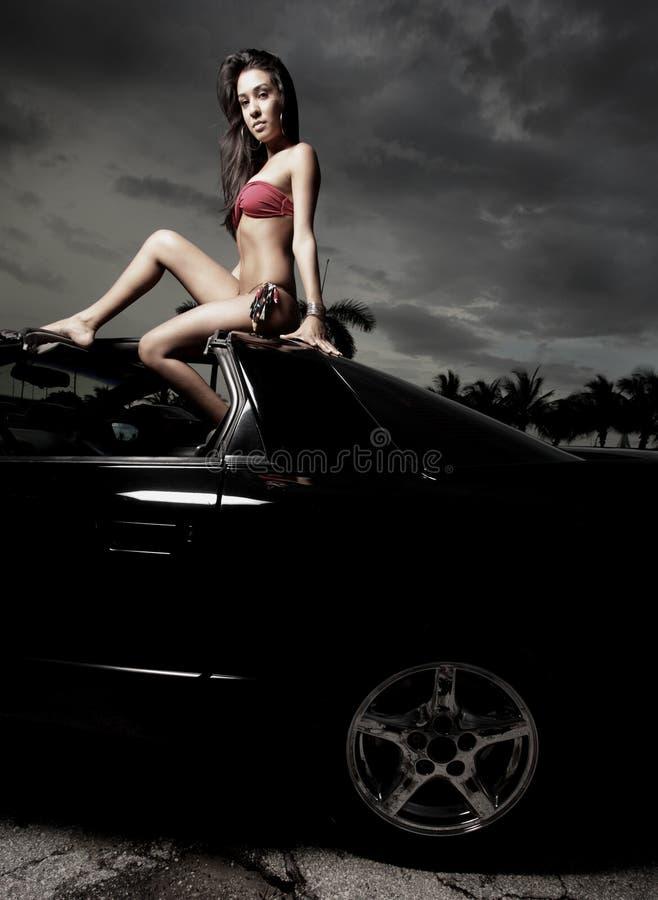 женщина автомобиля сидя стоковое изображение rf