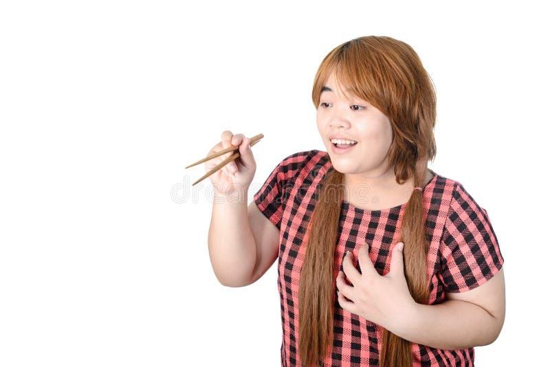Женщина азиата толстенькая держа палочки, изолированные на белом backgrou стоковая фотография