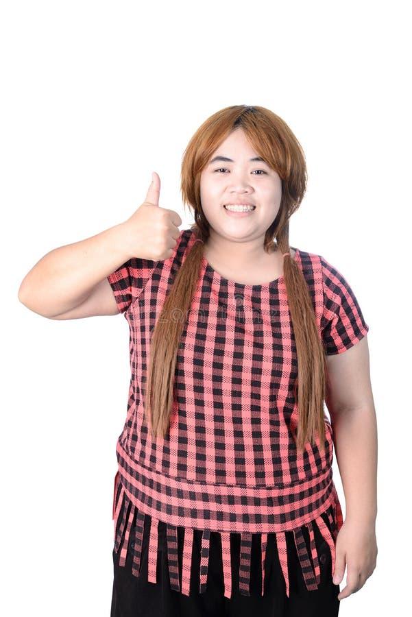 Женщина азиата толстенькая делая большие пальцы руки вверх с усмехаться, изолированный на w стоковые фотографии rf