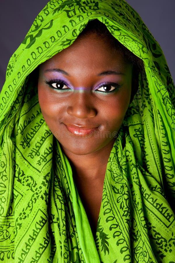 женщина африканского headwrap ся стоковое изображение