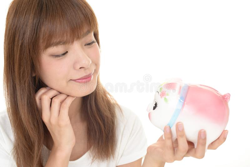 женщина банка piggy стоковая фотография rf