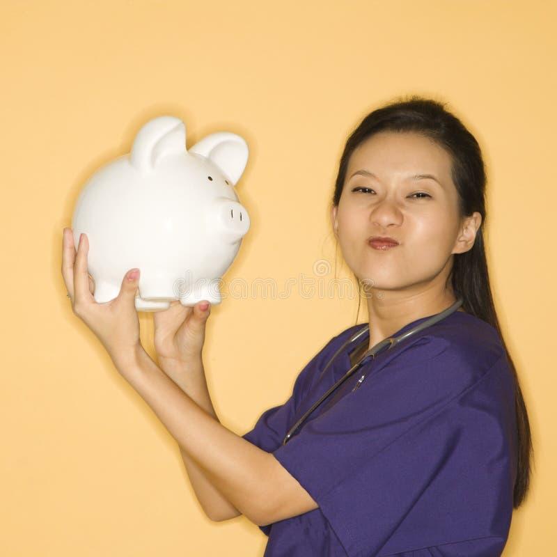 женщина банка piggy стоковые изображения rf