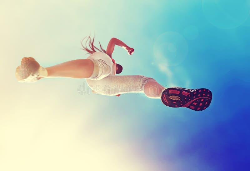 Женщина бегуна стоковое фото rf