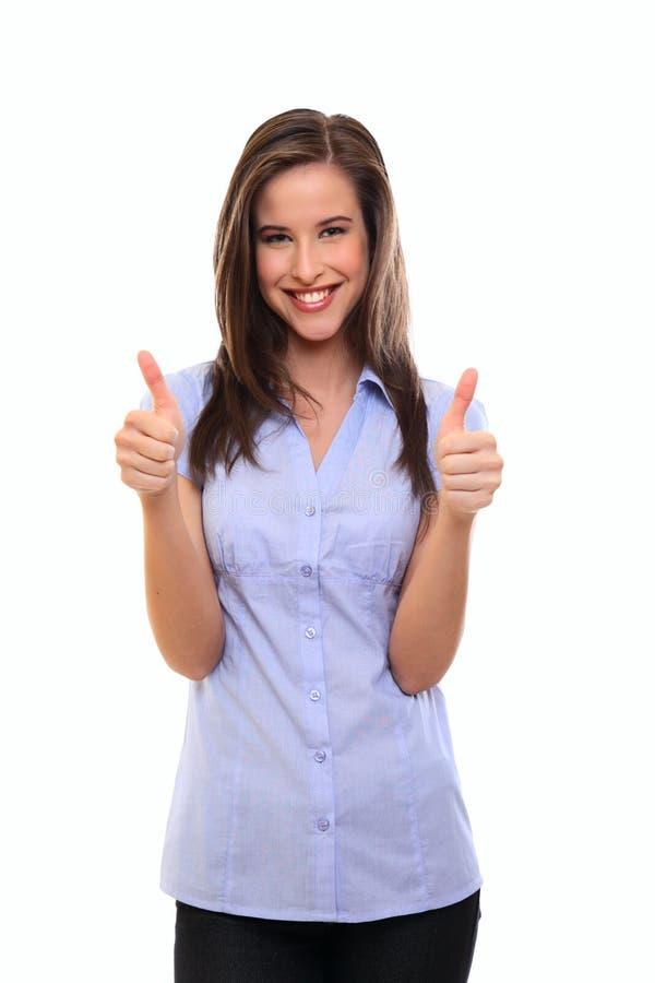 Женщина брюнет с большими пальцами руки вверх стоковые изображения