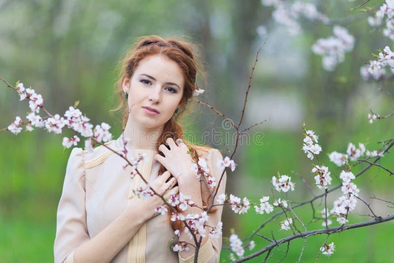 Женщина весной стоковое фото rf