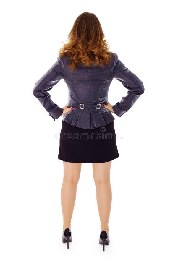 женщина взгляда костюма дела задняя стоковое фото
