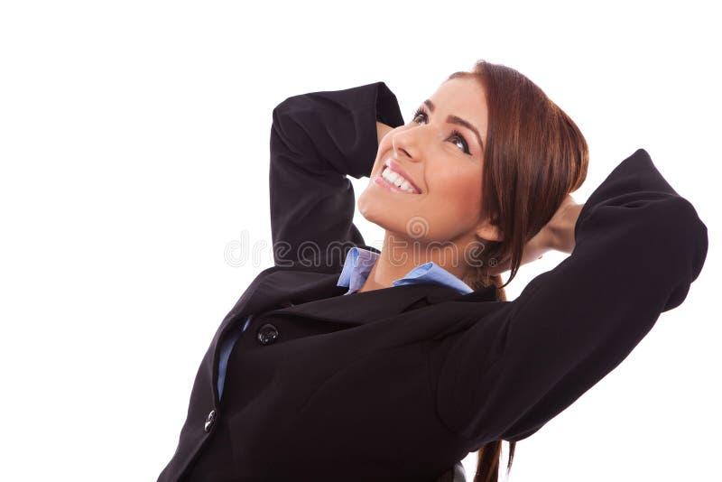 женщина взгляда со стороны дела relaxed стоковая фотография