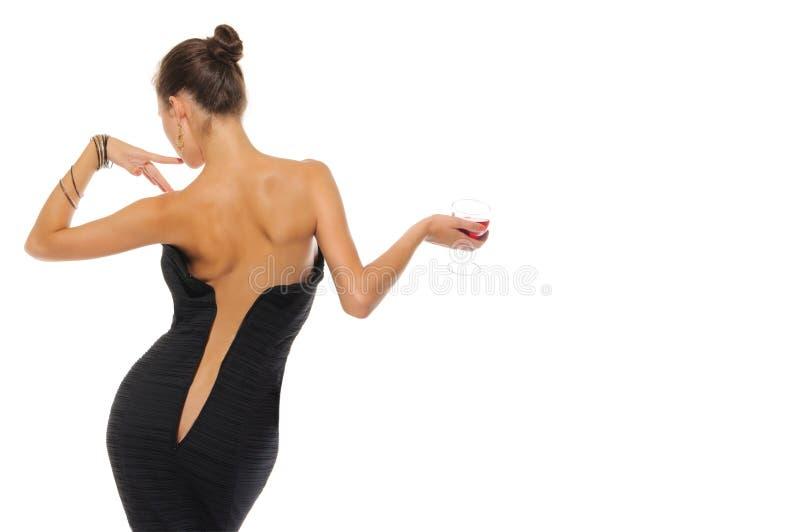 женщина вина платья unbuttoned стеклом стоковое изображение rf