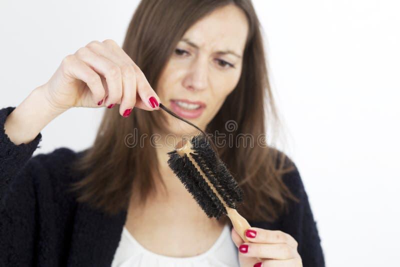 женщина волос освобождая стоковое фото rf