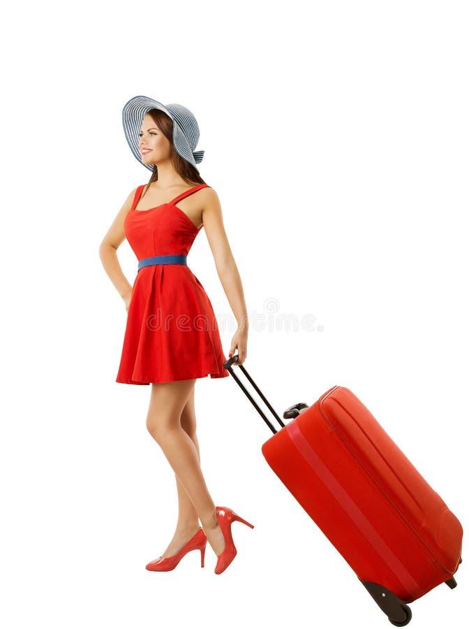 Женщина вытягивая багаж чемодана, носит изолированный багаж, белизну стоковое изображение