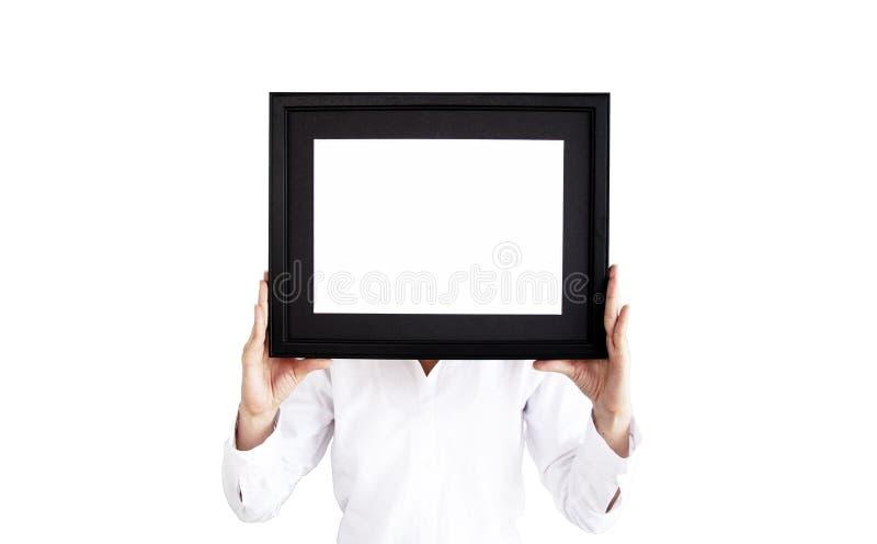 Женщина в белой рубашке держа рамку фото пустое изображение рамки стоковое изображение rf