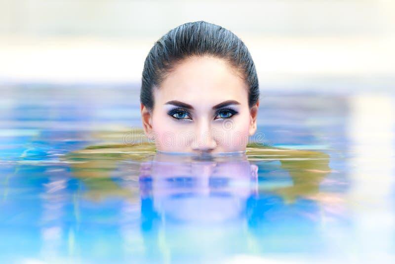 Женщина в воде стоковые фото