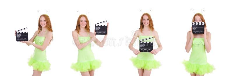 Женщина в зеленом платье с доской фильма стоковые фотографии rf