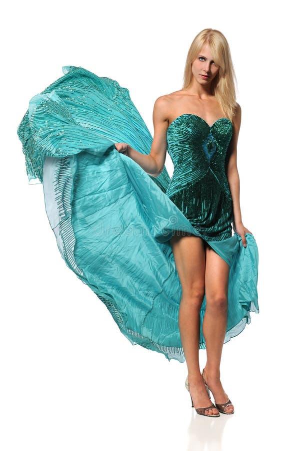 Женщина в изумрудном платье стоковое фото