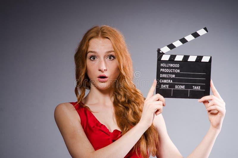 Женщина в красном платье стоковые изображения
