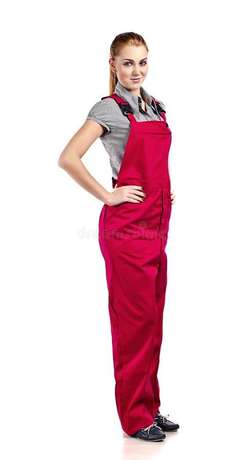 Женщина в красных прозодеждах, изолированных на белизне стоковые фотографии rf