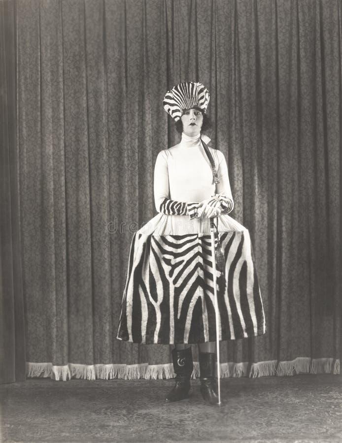 Женщина в моде зебры стоковые изображения