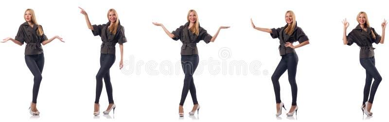 Женщина в одежде моды изолированной на белизне стоковые фото