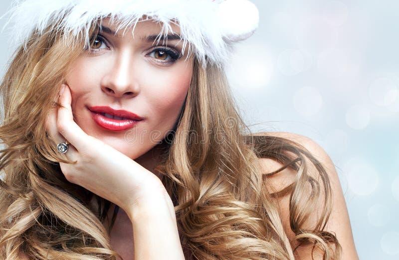Женщина в одеждах Санта Клауса стоковое фото