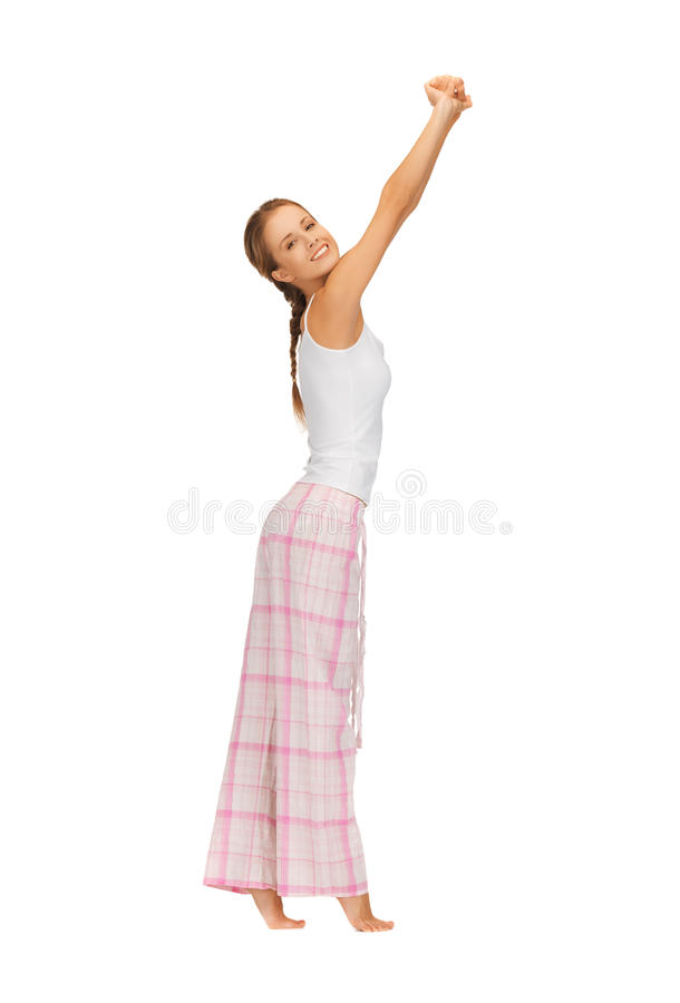 Женщина в пижамах делая тренировку утра стоковые изображения rf