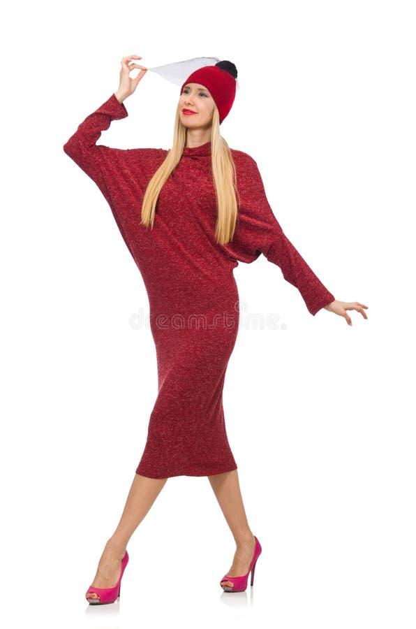 Женщина в платье bordo изолированном на белизне стоковое фото