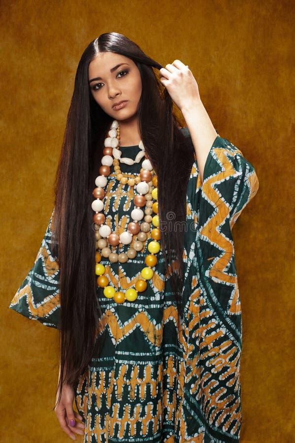 Женщина в этническом платье стоковое фото rf