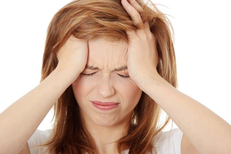 женщина головной боли стоковая фотография