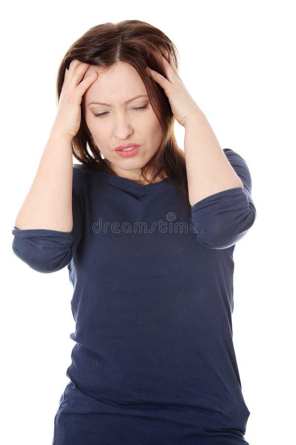 женщина головной боли стоковое фото rf