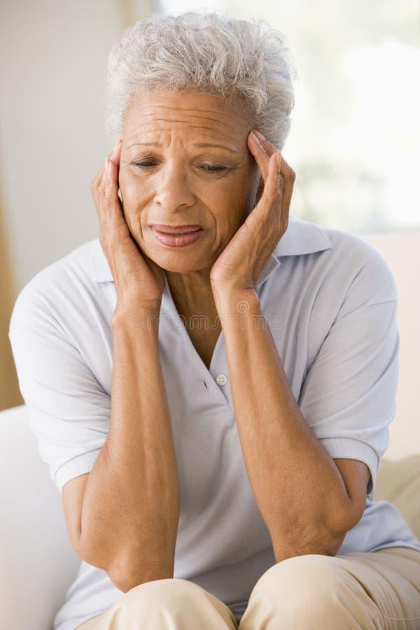 женщина головной боли стоковое изображение rf