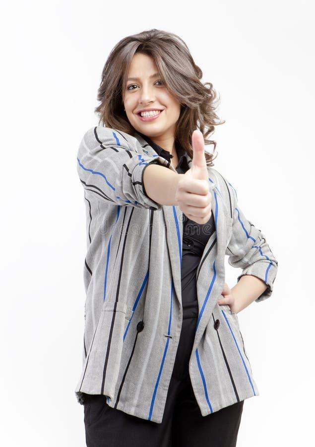 Женщина давая большие пальцы руки поднимает знак стоковые изображения rf