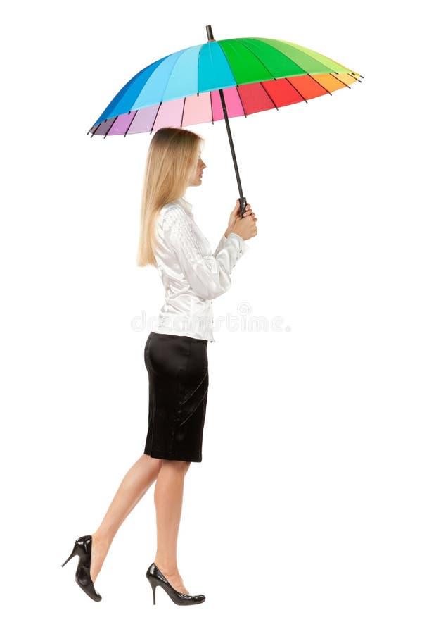 Женщина дела под зонтиком стоковое фото