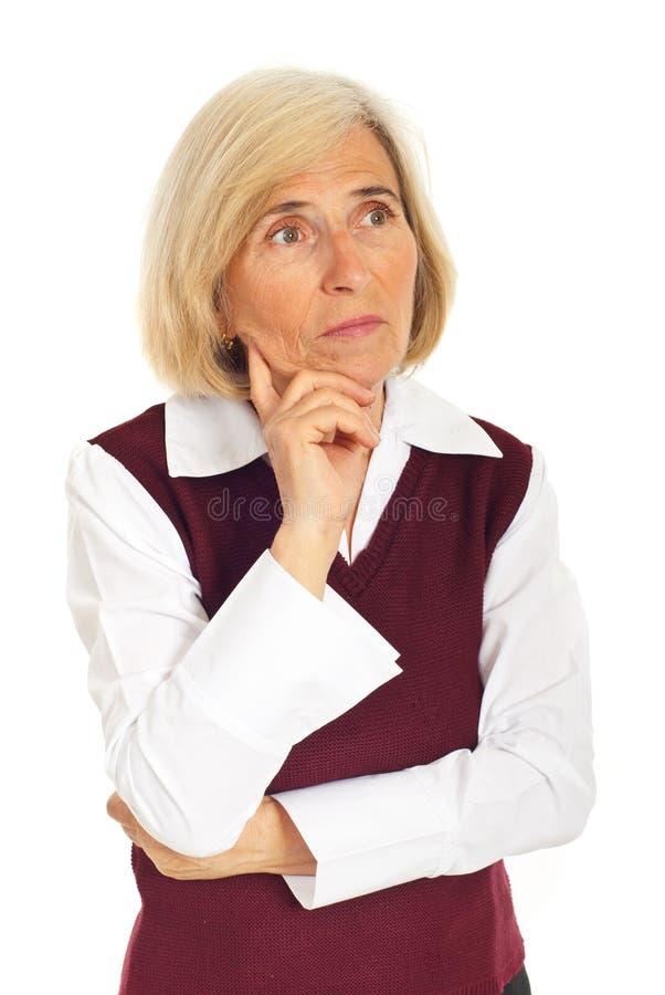 женщина дела старшая думая стоковое фото rf