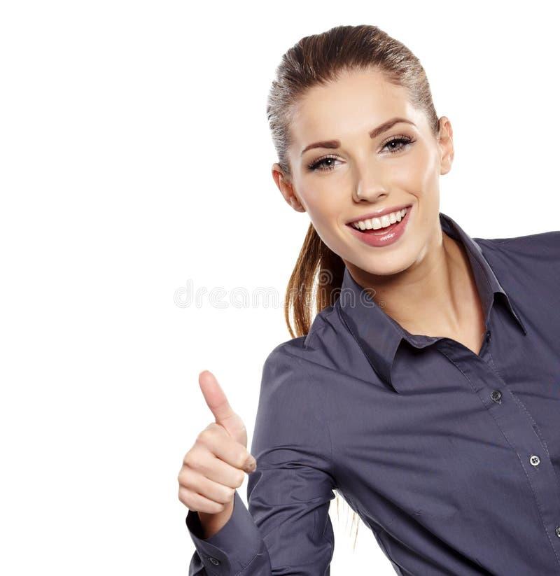 Женщина дела с одобренным знаком руки стоковые фото