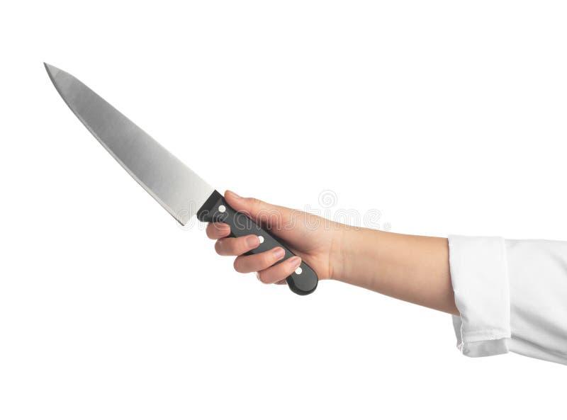 Женщина держа нож шеф-повара на белой предпосылке стоковое фото rf