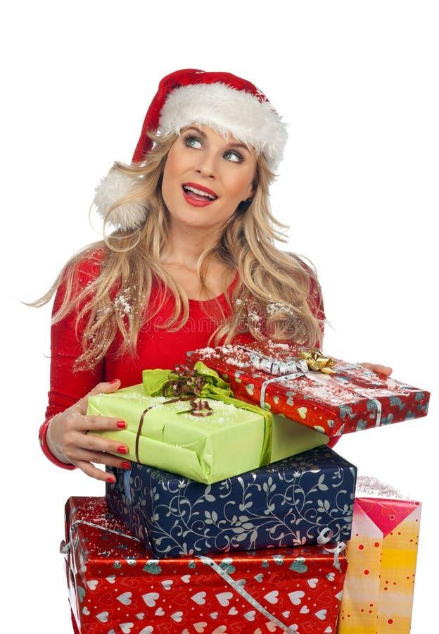 Женщина держа подарки рождества стоковое изображение