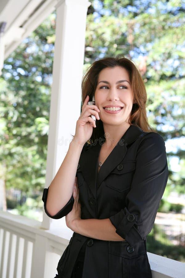 женщина домашнего телефона стоковые изображения rf