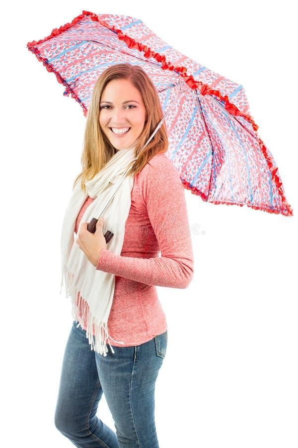 Женщина держа зонтик стоковая фотография