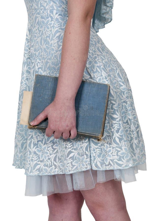 Женщина держа книгу стоковые фото
