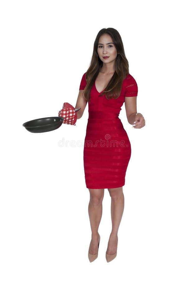 Женщина держа сковороду стоковая фотография rf