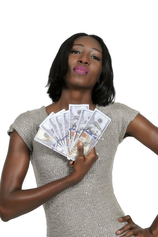 Женщина держа 100 счетов доллара стоковое изображение