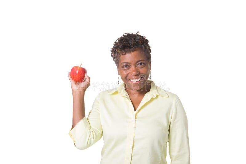 Женщина держа яблоко стоковая фотография
